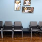 Shantung Graphite Healthcare Vinyl with Silver Frame, Black Arm Caps and Black Tables